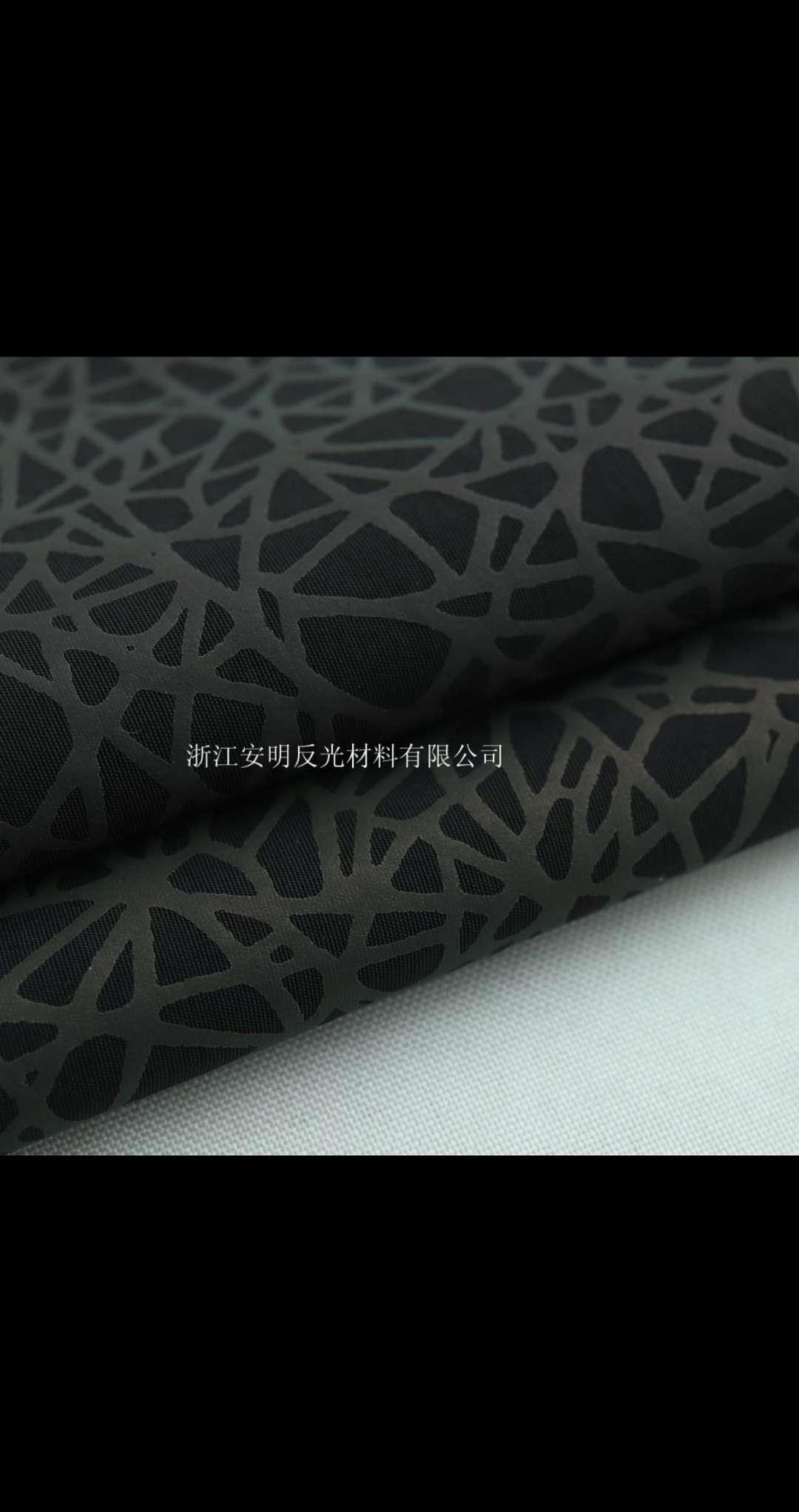 厂家直供 黑色七彩鸟巢棉感面料 时装面料