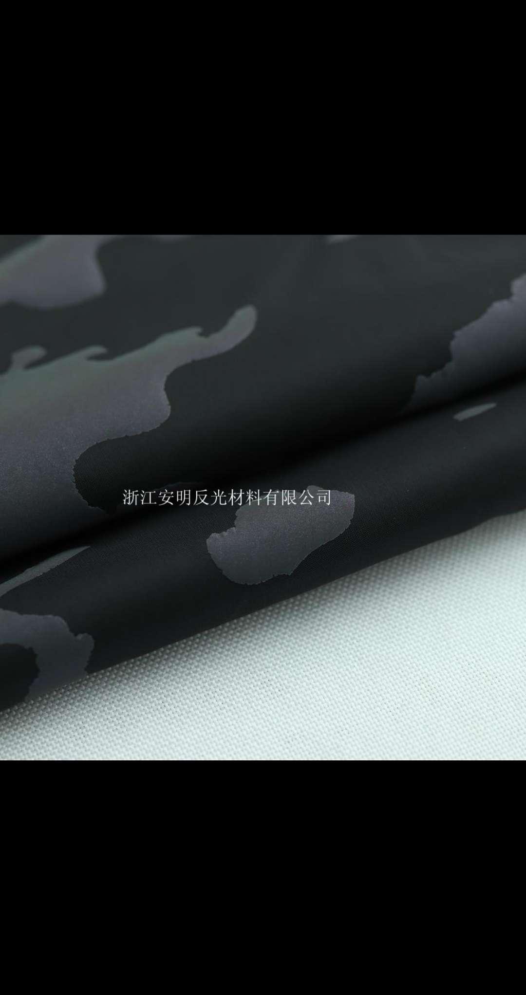 厂家直供 黑色七彩迷彩尼丝仿面料 时装面料