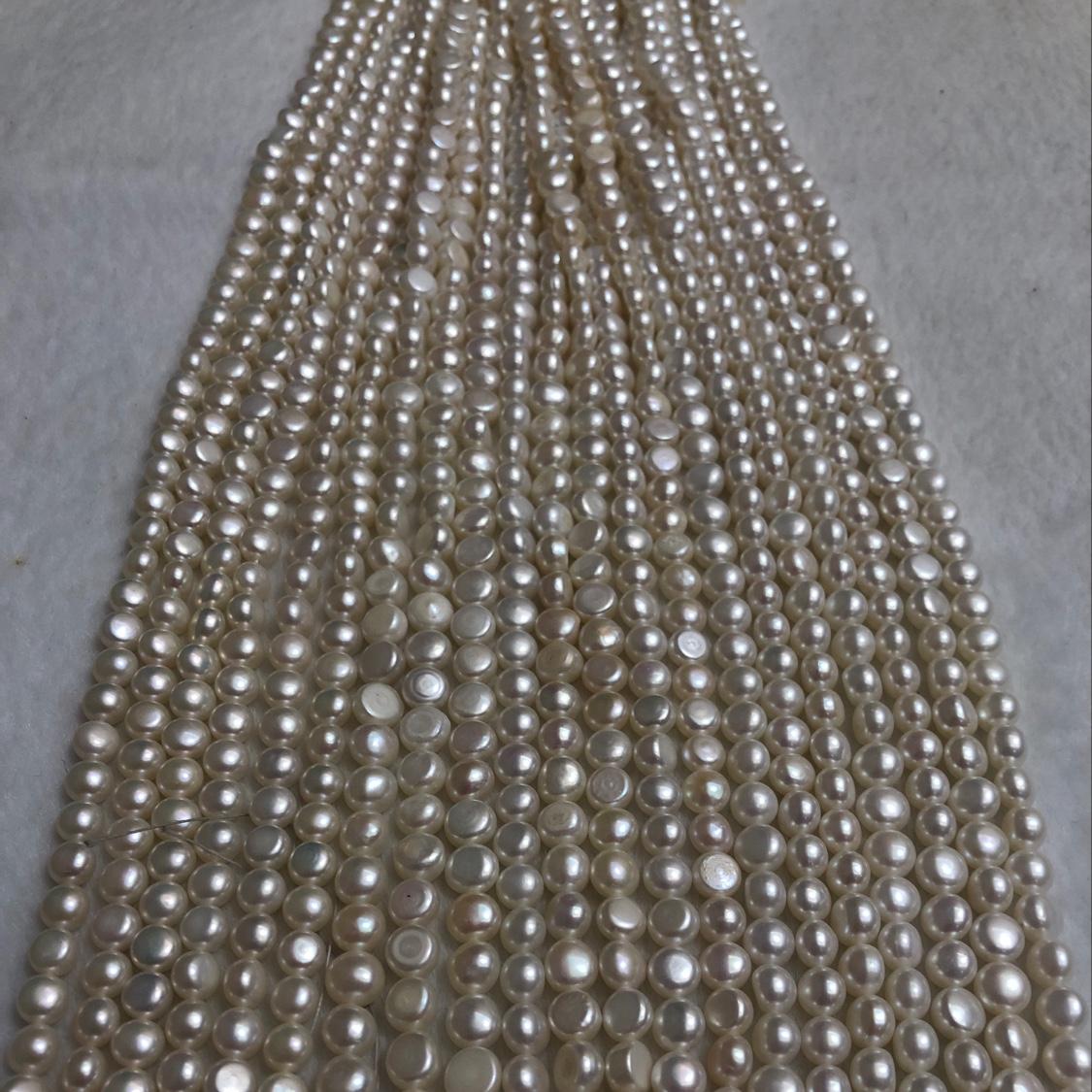 6一7天然淡水珍珠,无瑕透亮襾面光