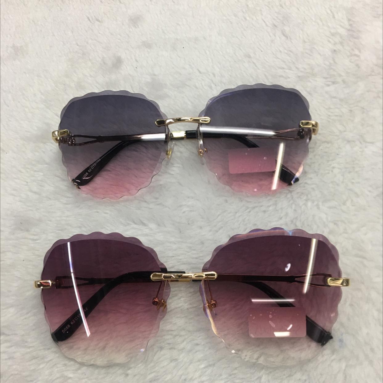 椭圆型无框花边款女士太阳眼镜