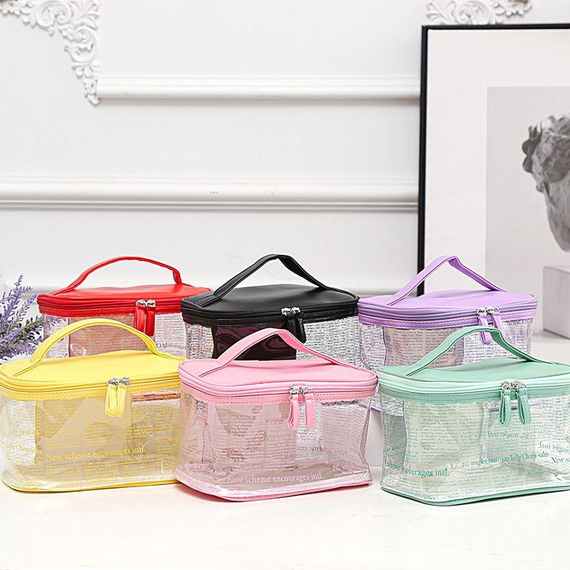 2020新款Ins热销韩版PVC透明化妆包源头厂货创意海报纹防水手提包