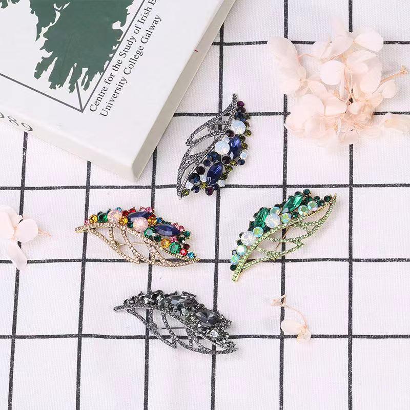 厂家直销外贸热销镂空玻璃树叶胸针时尚气质衣服配饰